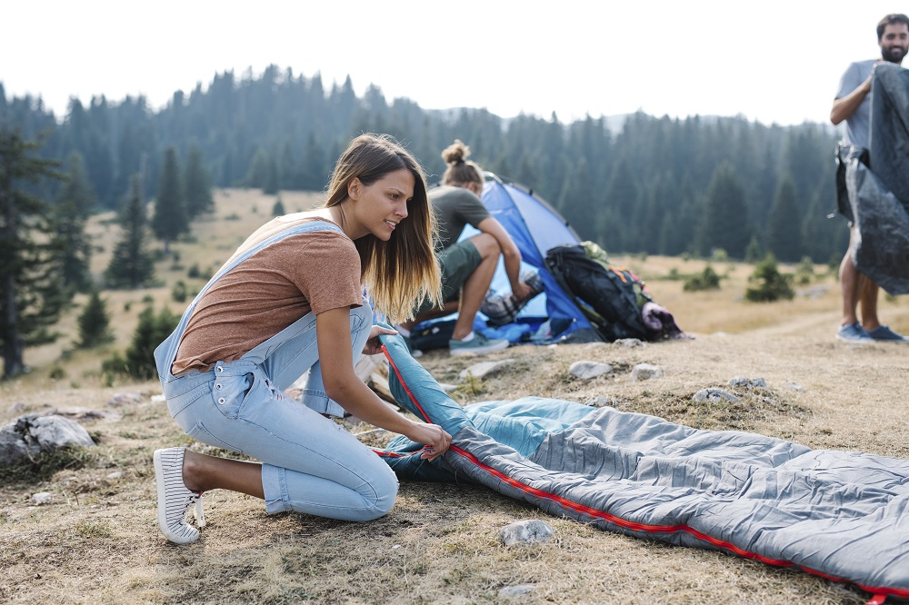 girl setting up camp