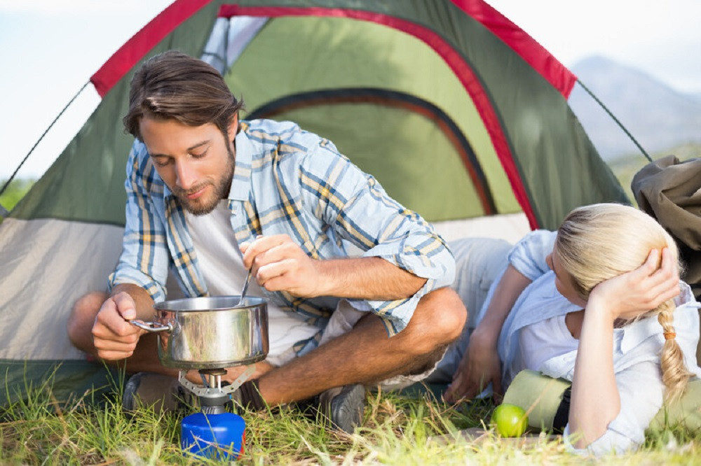couple cooking while camping