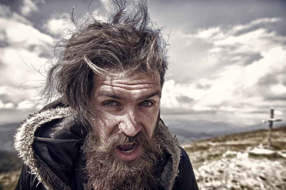 man in windy climate