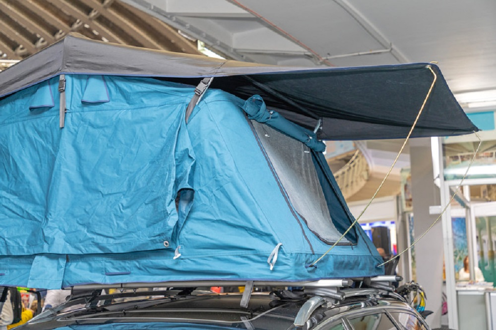 canopy tent on top of a car